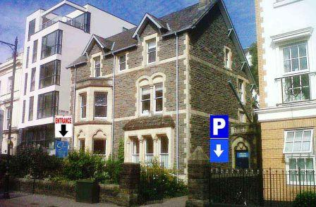 photo of City Marshall Massage location at Quaker Meeting House cardiff. Photo of building entrance and a sign showing where the free parking is located