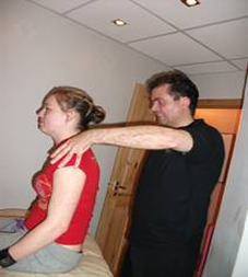 Lady getting Sports massage for whiplash therapy for treatment in whiplash or sports injuries