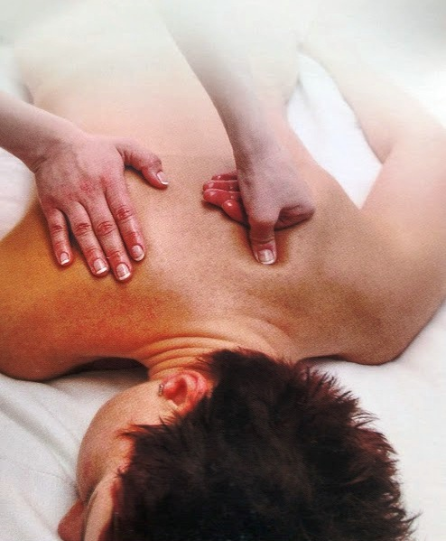 lady having deep tissue massage for back pain in Cardiff