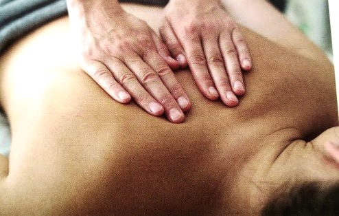 lady with severe back pain having sports massage in our cardiff clinic