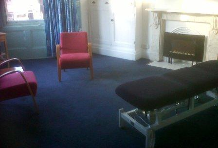 massage therapy room at quaker meeting house - luxurious room with fire place and bay windows