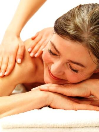 Disabled lady having aromatherapy sports massage at our cardiff clinic