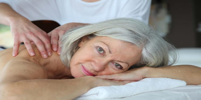 old lady in Cardiff having soft tissue myofascial release massage for her sciatica